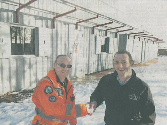 Paul Burnage, paramedic and base manager for the Pride of Cumbria at Langwathby, and Adrian Banks, commercial manager for Atkinson Building Contractors