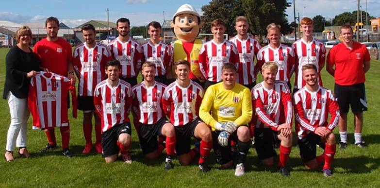 Tracy Little and Atkinson's mascot present the new kit to WUFC