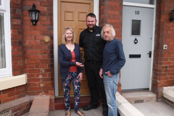 Project Manager for both jobs, Martyn Crouch, hands over the keys to Mr and Mrs Huggon